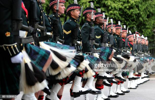 The Royal Scots Borderers march through the gates to Balmoral before being inspected by Queen Elizabeth II as she takes up summer residence there
