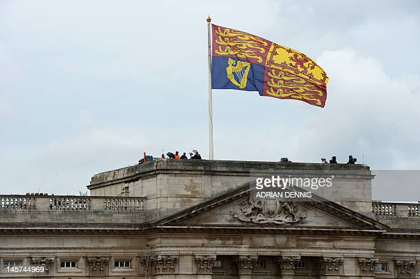 The Royal Standar flag flutters on top of Buckingham Palace before Queen Elizabeth II leaves for St Paul's Cathedral to attend the National Service...