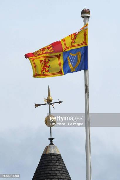 The Royal Standard flies above Palace of Holyroodhouse in Edinburgh ahead of the wedding of Zara Phillips and Mike Tindall tomorrow