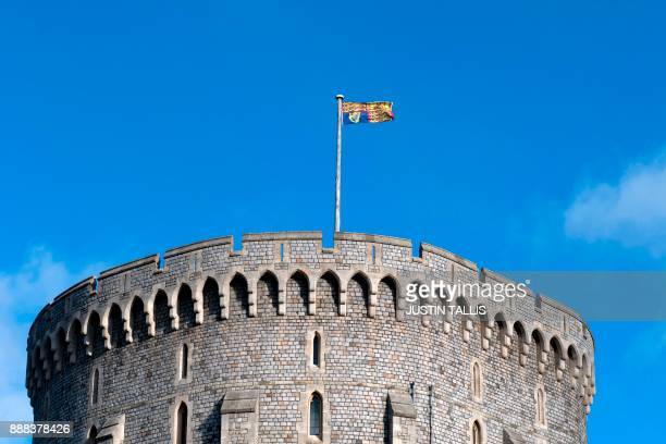 The Royal Standard flutters in the breeze above Windsor Castle in Windsor west of London on December 8 2017 Britain's Prince Harry will marry his US...