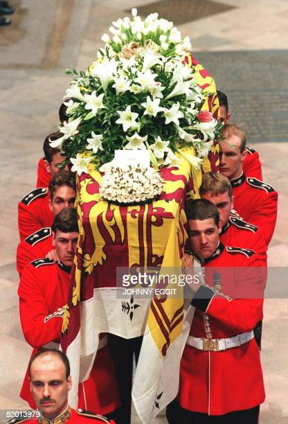 the Royal Standarddraped coffin of Diana Princess of Wales is carried by a bearer of Welsh Guards into Westminster Abbey in London for the funeral...