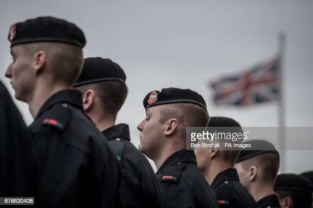 The Royal Tank Regiment troops in their distinctive black coveralls and berets on parade during a service to mark centenary anniversary of the Battle...