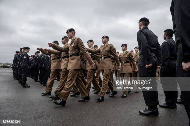 The Royal Tank Regiment troops march during a parade to mark centenary anniversary of the Battle of Cambrai at Tidworth Camp Wiltshire