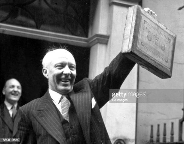 The Rt Hon Hugh Dalton MP Chancellor of the Exchequer holding the famous red despatch case containing the Budget secrets leaving Downing Street...