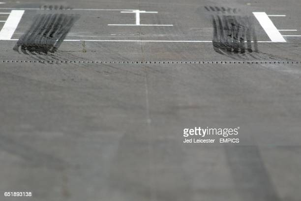 The rubber tracks left after a car screeched away from a pitstop