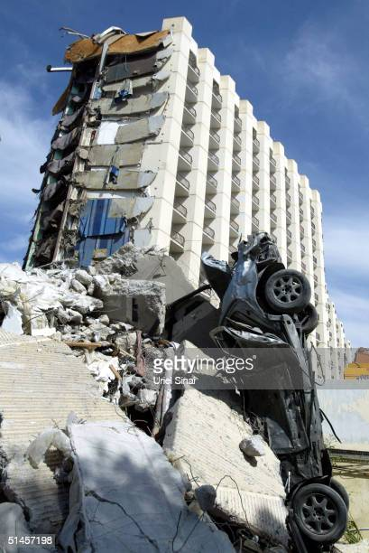 The rubble of the Hilton hotel is seen on October 9 2004 in Taba Egypt Car bombs ripped through the hotel and two other beach resorts packed with...