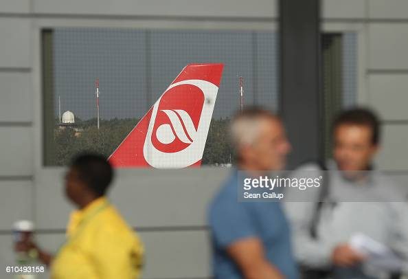 The rudder of a passenger plane of German airliner Air Berlin is seen through a fenced window at Tegel Airport on September 26 2016 in Berlin Germany...