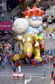 The Rugrats and Spike balloons float through Times Square during the annual Macy's Thanksgiving Day Parade in New York City An estimated one million...