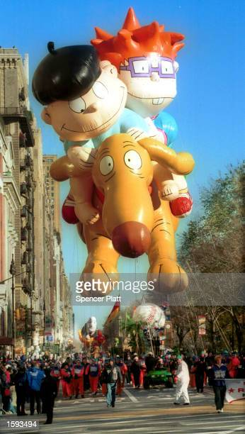 The Rugrats are led down Broadway during the 74th annual Macy's Thanksgiving Day Parade November 23 2000 in New York City The thermometer read 27...