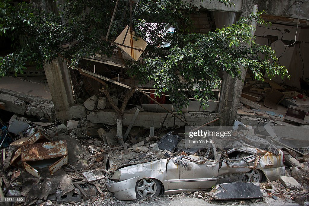 The ruin of a collapsed building are seen at a earthquake memorial park at the Beichuan town in Sichuan province on April 24, 2013 in Chengdu, China. The Beichuan earthquake memorial was built in memory of the over 70,000 that perished in the deadly 2008 quake that struck Sichuan province and was built near the Beichuan Middle School, where over 1,000 students and teachers died. With the five year quake anniversary only a few weeks away, residents of Sichuan province are coming to grips with the April 20 earthquake in nearby Ya'An that claimed the lives of over 190 people and injured thousands.