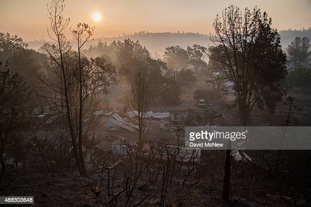 The ruins homes that burned in the Valley Fire are seen at sunrise on September 15 2015 in Middletown CaliforniaThe 104squaremile fire is only 15...