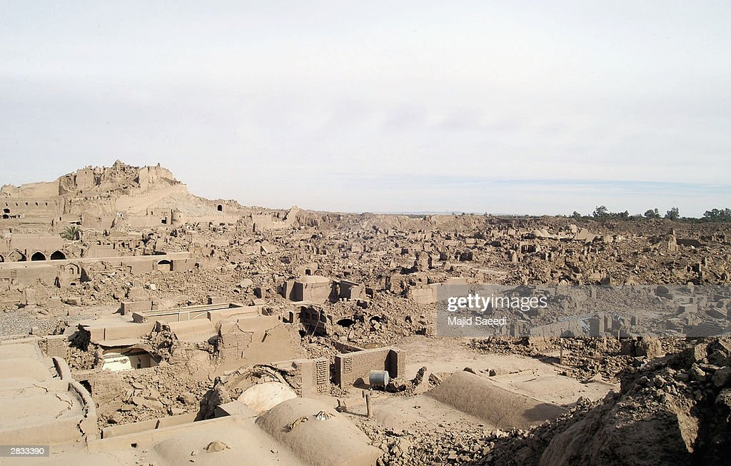 The ruins of a fortress look over the devastated town on December 27 2003 in Bam Iran An earthquake registering 65 on the Richter scale hit the...