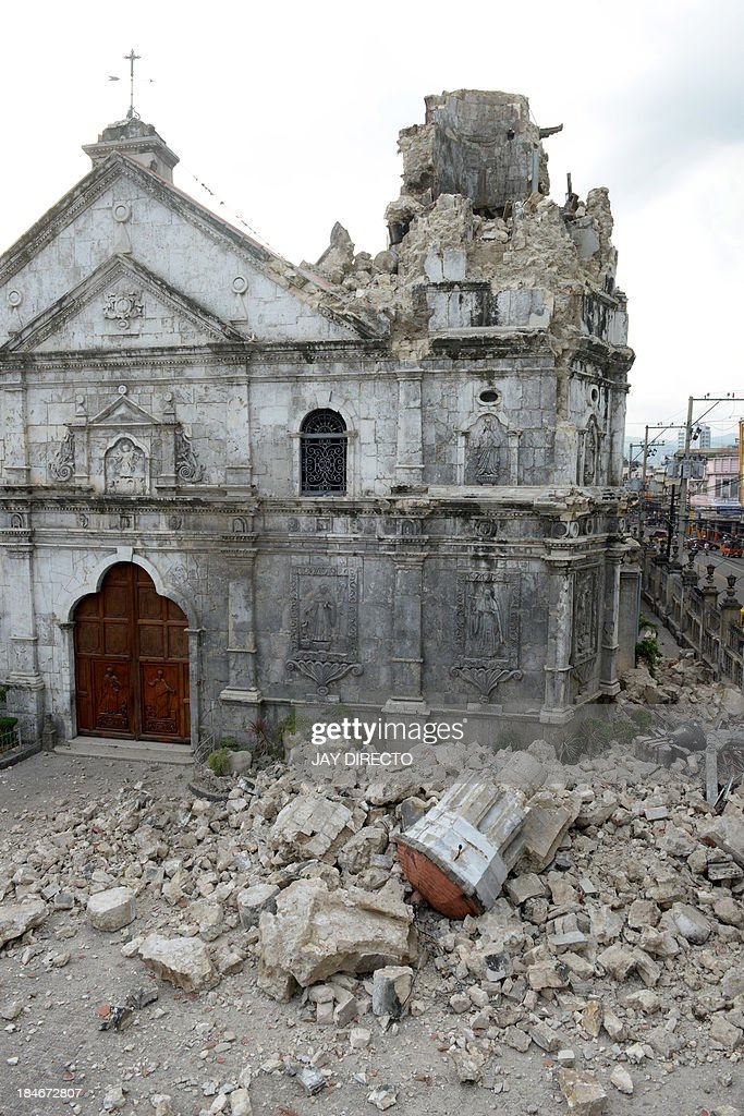 The ruins of Basilica Minore del Santo Nino bell tower following a 7.1-magnitude quake in Cebu on October 15, 2013. A powerful earthquake killed at least 73 people on October 15 as it tore down modern buildings, destroyed historic churches and triggered terrified stampedes across popular tourist islands in the Philippines. AFP PHOTO / Jay DIRECTO