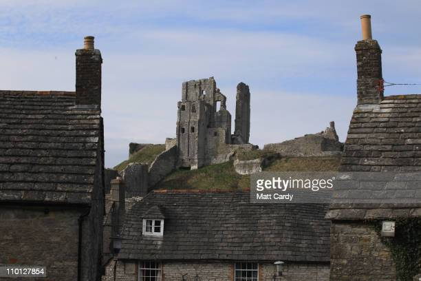 The ruins of the National Trust's Corfe Castle dominates the village beneath on March 15 2011 in Dorset England The 11th century castle was built in...
