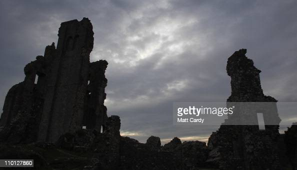 The ruins of the National Trust's Corfe Castle stand on March 15 2011 in Dorset England The 11th century castle was built in a gap in the Purbeck...