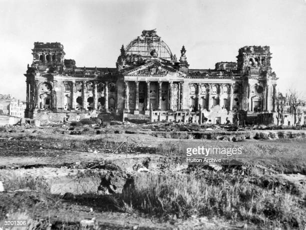 The ruins of the Reichstag building in Berlin Soviet troops reached Berlin in late April of that year with extensive bombardment Adolf Hitler...