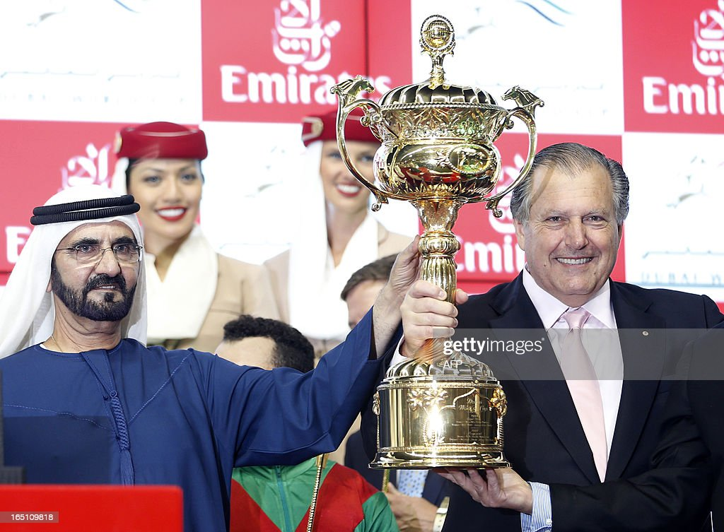 The ruler of Dubai Sheikh Mohammed Bin Rashid al-Maktoum (L) and the US owner of Animal Kingdom, the winner of the $10 million Dubai World Cup, the world's richest horse race, at Meydan race track in Dubai on March 30, 2013.