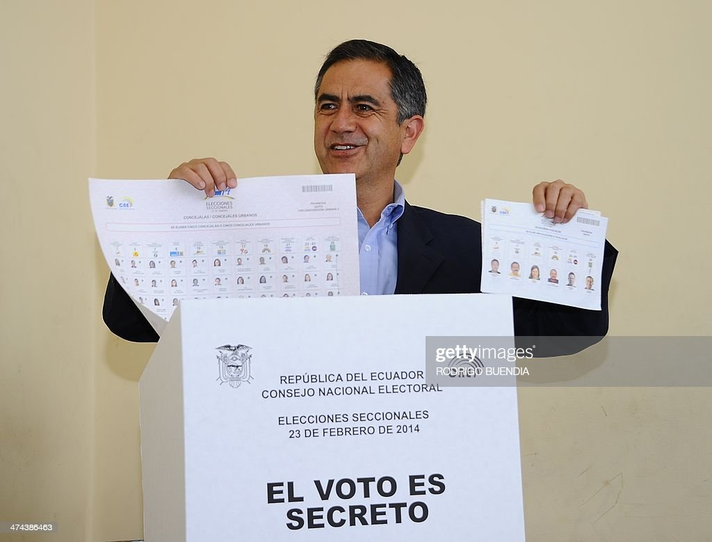 The ruling party's candidate for Quito's Mayor's Office, Augusto Barrera, poses before casting his vote at a polling station in Quito, as Ecuador holds municipal elections on February 23, 2014.
