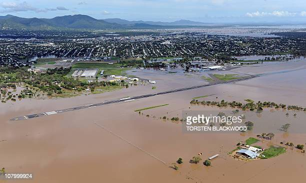 The runway is submerged at Rockhampton Airport after the swollen Fitzroy River broke its banks and flooded much of the city on January 5 2011 Tens of...