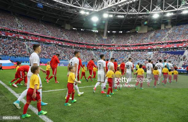 The Russia and New Zealand teams walk out prior to the FIFA Confederations Cup Russia 2017 Group A match between Russia and New Zealand at Saint...