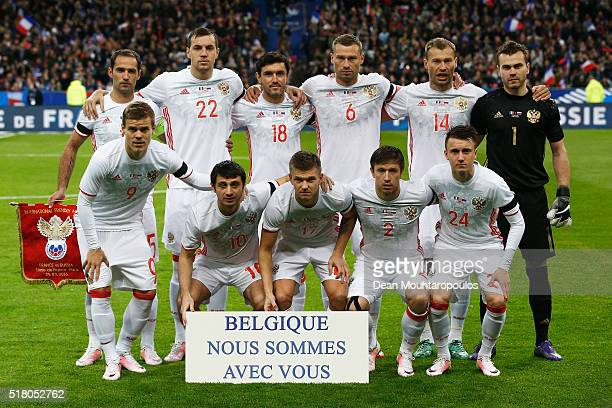 The Russia team line up with a sign saying 'Belgique nous sommer avec vous' or 'Belgium we are with you' prior to the International Friendly match...