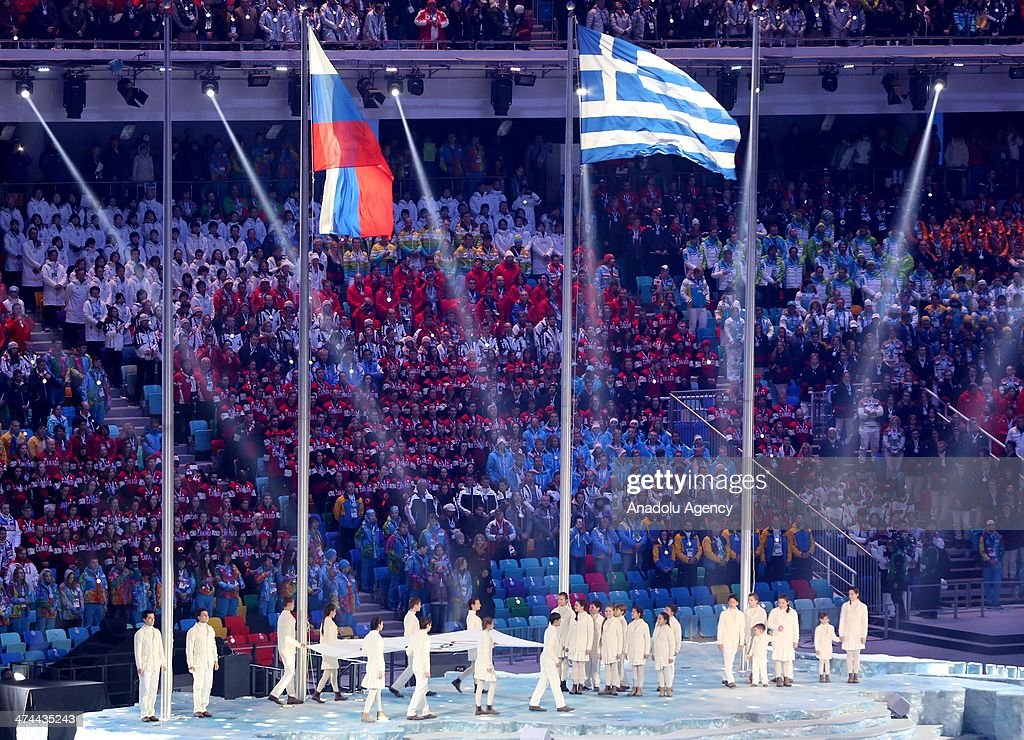 The Russian and the Greek flags fly during the Closing Ceremony of the Sochi 2014 Winter Olympics at Fisht Olympic Stadium on February 23, 2014.