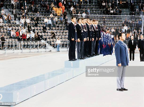The Russian basketball team receive the gold medal flanked by the third placed Cuban team and a vacant rostrum where the silver medalist USA team...
