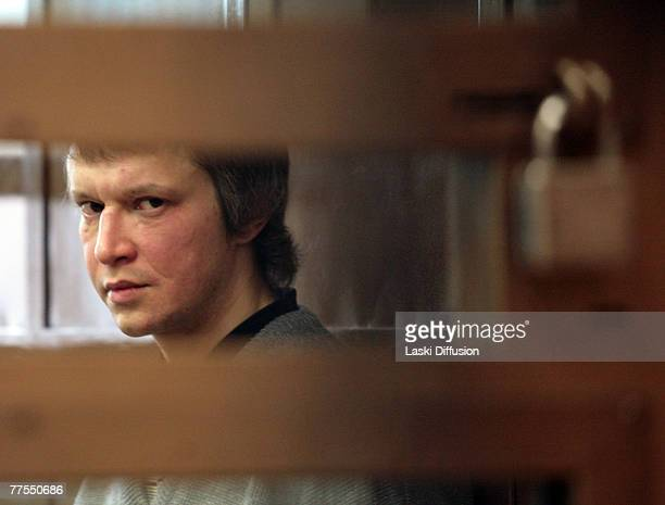 The Russian Chessboard killer Alexander Pichushkin looks on from a cell in a Moscow court room awaiting his sentence October 29 2007 in Moscow Russia...
