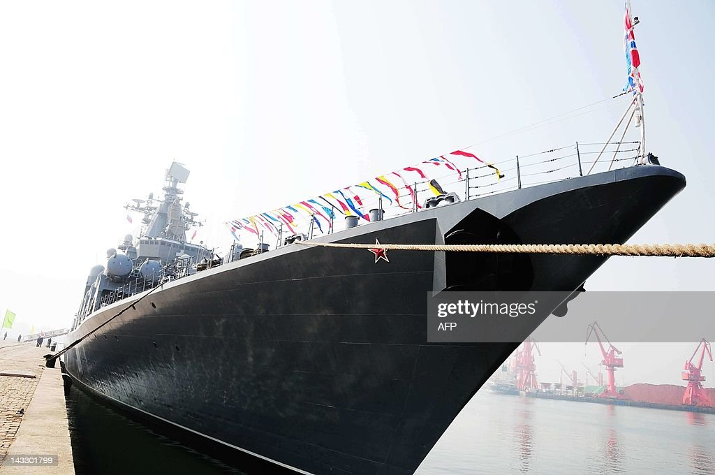 The Russian destroyer Admiral Vinogradov is berthed at the People's Liberation Army (PLA) naval base in Qingdao, northeastern China's Shandong province on April 23, 2012, prior to the start of the Sino-Russian joint naval exercises. China and Russia launched their first joint naval exercises, with war games in the Yellow Sea that come amid tensions between China and its Asian neighbours over territorial claims. CHINA