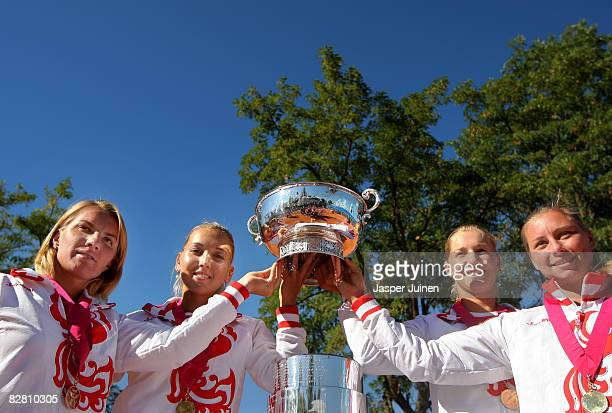 The Russian Fed Cup team Svetlana Kuznetsova Elena Vesnina Ekaterina Makarova and Vera Zvonareva pose with the Fed Cup trophy on day two of the Fed...