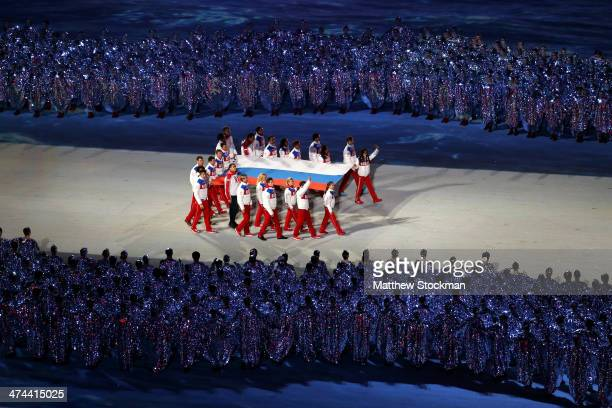 The Russian flag is brought into the arena by Russian athletes during the 2014 Sochi Winter Olympics Closing Ceremony at Fisht Olympic Stadium on...