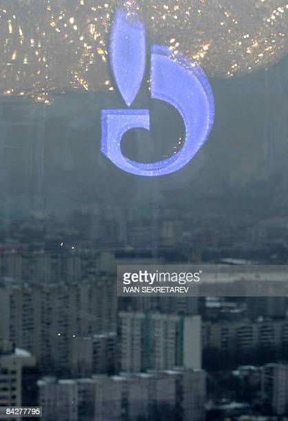 The Russian Gazprom emblem is reflected in the window of the office of its Chief Executive Officer Alexei Miller before his meeting with Slovak Prime...