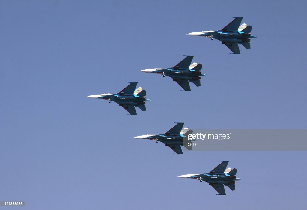 The Russian Knights aerobatic demonstration team of the Russian Air Force fly in their Sukhoi SU-27s during an aerial display on the fifth and final day of Aero India 2013 at Yelahanka Air Force station in Bangalore on February 10, 2013. India, the world's leading importer of weaponry, opened one of Asia's biggest aviation trade shows February 6 with Western suppliers eyeing lucrative deals and a Chinese delegation attending for the first time.