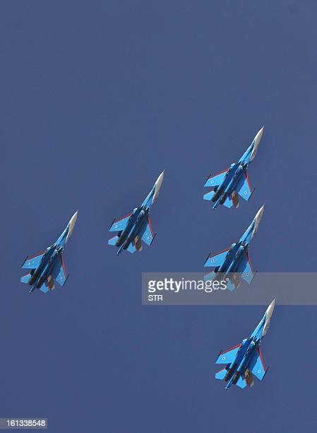 The Russian Knights aerobatic demonstration team of the Russian Air Force fly in arrow head formation in their Sukhoi SU27s during an aerial display...