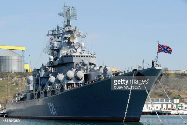 The Russian Navy flagship missile cruiser 'Moskva' remains docked in the bay of the Crimean city of Sevastopolon March 30 2014 US Secretary of State...