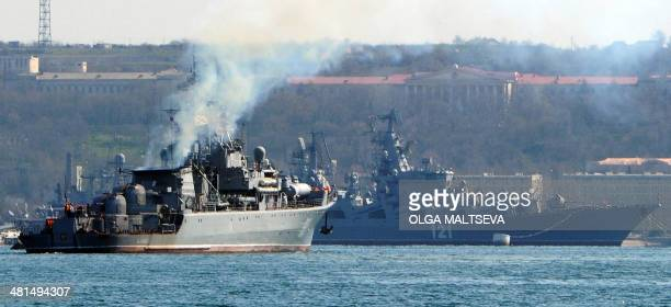 The Russian navy patrol ship 'Pytliviy' navigates near the Russian Navy flagship missile cruiser 'Moskva' docked in the bay of the Crimean city of...
