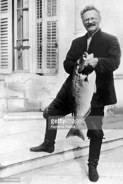 The Russian revolutionary Leon TROTSKI posing with a carp in Mexico during his exile in 1937