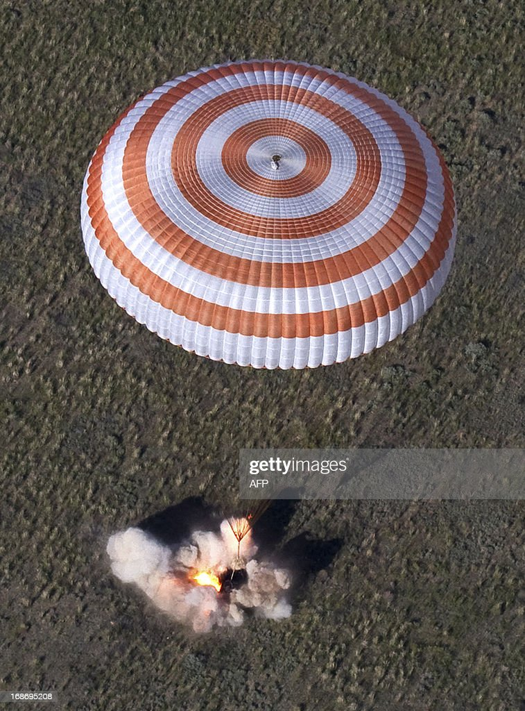 The Russian Soyuz space capsule with US astronaut Tom Marshburn Canadian spaceman Chris Hadfield and Russian cosmonaut Roman Romanenko aboard lands...
