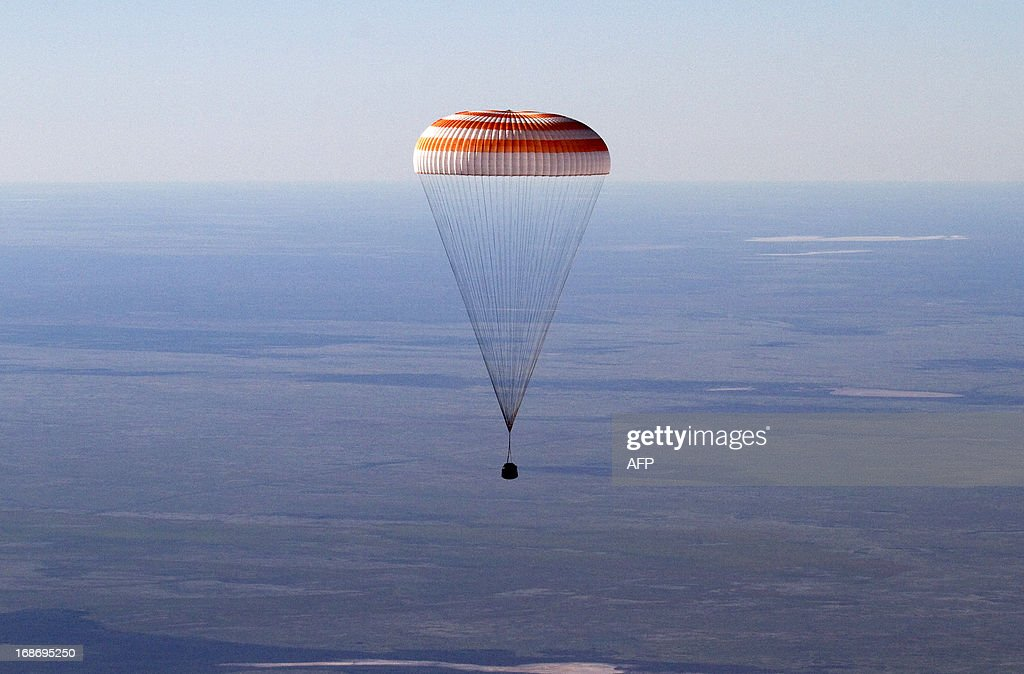 The Russian Soyuz space capsule with US astronaut Tom Marshburn Canadian spaceman Chris Hadfield and Russian cosmonaut Roman Romanenko aboard...