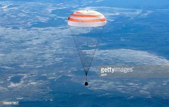 The Russian Soyuz space capsule with US astronaut Tom Marshburn Canadian spaceman Chris Hadfield and Russian cosmonaut Roman Romanenko aboard...
