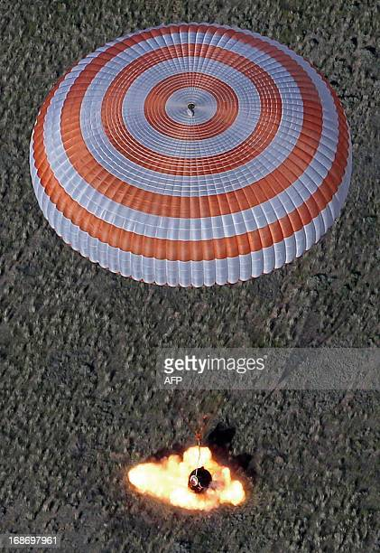 The Russian Soyuz space capsule with US astronaut Tom Marshburn Canadian spaceman Chris Hadfield and Russian cosmonaut Roman Romanenko aboard lands...