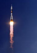 The Russian Soyuz TMA15 rocket carrying Canadian astronaut Robert Thirsk European Space Agency astronaut Frank De Winne of Belgium and Russian...