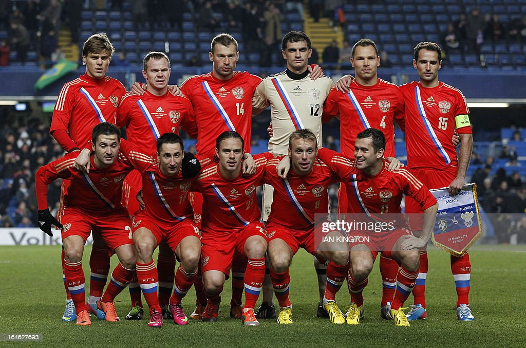 The Russian starting XI, (L-R top row) Aleksandr Kokorin, Alexander Anyukov, Vasily Berezutskiy, Vladimir Gabulov, Sergey Ignashevich, Roman Shirokov, (L-R bottom row) Victor Fayzulin, Vladimir Bystrov , Andrey Eschenko, Denis Glushakor and Aleksandr Kerzhakov pose for the team photograph before the start of the international friendly football match between Brazil and Russia at Stamford Bridge stadium in London on March 25, 2013 .
