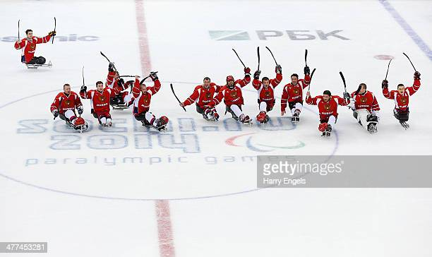 The Russian team celebrate victory after defeating Italy in the Ice Sledge Hockey Preliminary Round Group B match between Russia and Italy at Shayba...