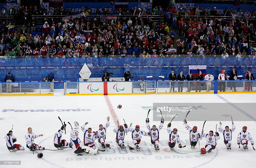 The Russian team celebrate victory during the Ice Sledge Hockey Preliminary Round Group B match between USA and Russia at the Shayba Arena during day four of the Sochi 2014 Paralympic Winter Games on March 11, 2014 in Sochi, Russia.