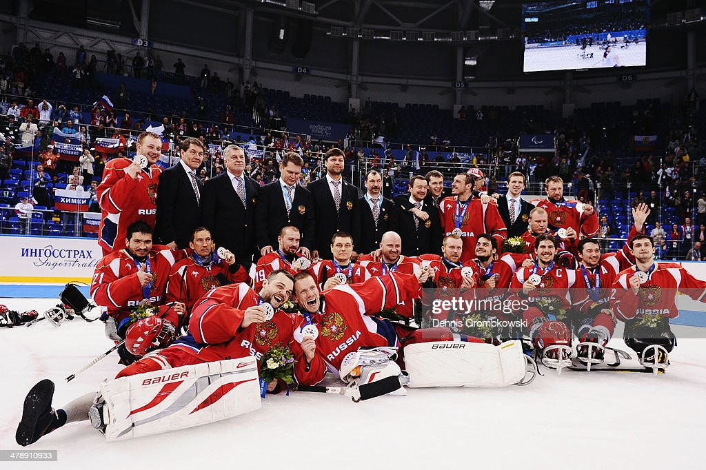 The Russian team celebrate winning the silver medal after the Ice Sledge Hockey Gold Medal game between the United States and Russia on day eight of the Sochi 2014 Paralympic Winter Games at Shayba Arena on March 15, 2014 in Sochi, Russia.