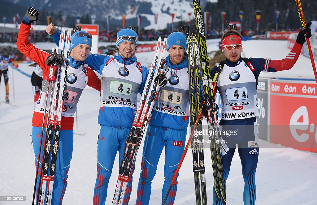 The Russian Team with (L - R) Maxim Tsvetkov of Russia, Timofey Lapshin of Russia, <a gi-track='captionPersonalityLinkClicked' href=/galleries/search?phrase=Dmitry+Malyshko&family=editorial&specificpeople=8734950 ng-click='$event.stopPropagation()'>Dmitry Malyshko</a> of Russia and <a gi-track='captionPersonalityLinkClicked' href=/galleries/search?phrase=Anton+Shipulin&family=editorial&specificpeople=6678388 ng-click='$event.stopPropagation()'>Anton Shipulin</a> of Russia celebrate after winning the Men's 4 x 7.5 km relay event in the IBU Biathlon World Cup on December 13, 2014 in Hochfilzen, Austria.