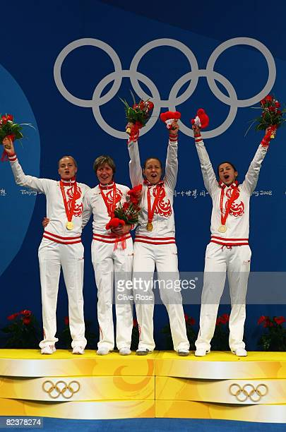 The Russian team with Svetlana Boyko Evgenia Lamonova Victoria Nikichina and Aida Shanaeva pose with the gold medal after the Fencing Women's Team...