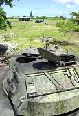 The rustedout shell of a military armored vehicle stands the test of time from the harsh elements on the island of Pagasa while a Philippine Air...