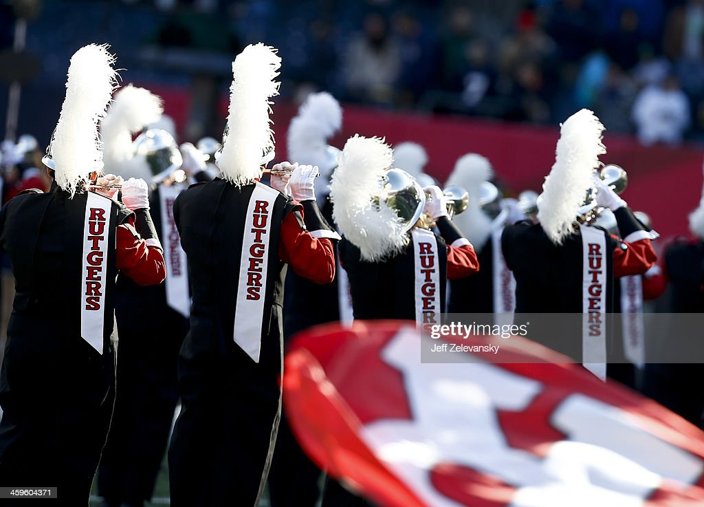 The Rutgers marching band performs prior to the New Era Pinstripe Bowl between the Notre Dame Fighting Irish and the Rutgers Scarlet Knights at Yankee Stadium on December 28, 2013 in the Bronx borough of New York City.